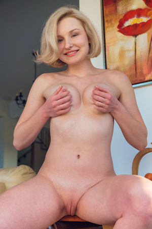 Blonde demonstrates appetizing tits with pale nipples and sweet bald pussy