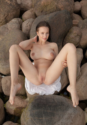 Agatha loves romantic environment seeing no problem in posing undressed on the rocks