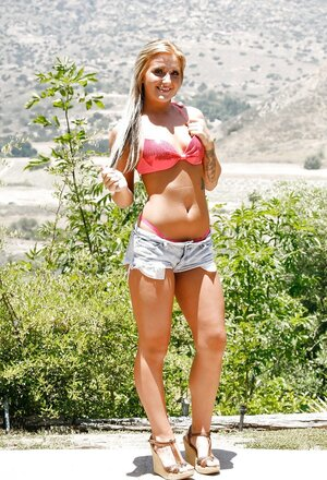 Lovely porn model likes to be nude on camera in front of beautiful nature