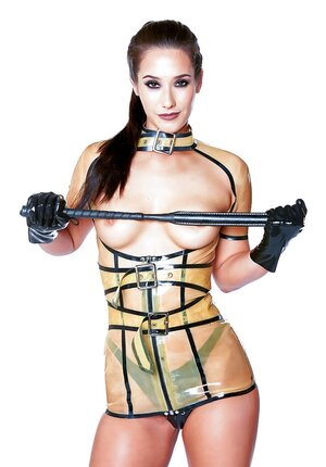 Dangerous vixen Eva Lovia in latex outfit, panties, high boots and moreover with a whip