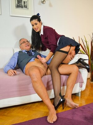 Brunette with a tie around neck fucked by more experienced cameraman in blue shirt