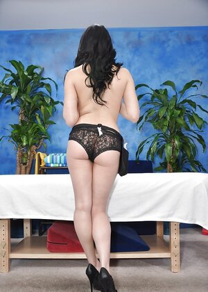 Black-haired cutie pie with pale skin gladly demonstrates tits and sexy panties
