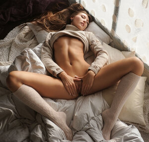 Floozy in sweater and plus leg-warmers feels hot inside and plus gets naked in bed