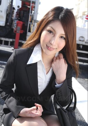 Charming Japanese secretary seductively poses while going at her work